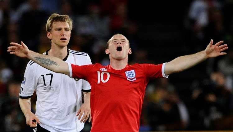 England's Wayne Rooney reacts near Germany's Per Mertesacker during their 2010 World Cup second round soccer match at Free State stadium in Bloemfontein June 27, 2010. Picture: REUTERS
