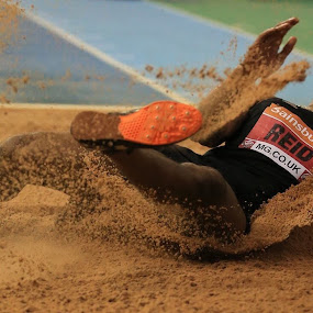 Sand Splash.  by Ron Russell - Sports & Fitness Other Sports ( sand, splash, male, long, athlete, jumper )