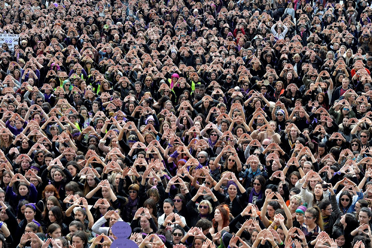 Protesters form triangles with their hands during a demonstration for women's rights in Bilbao, Spain, March 8 2018, on International Women's Day. Picture: REUTERS