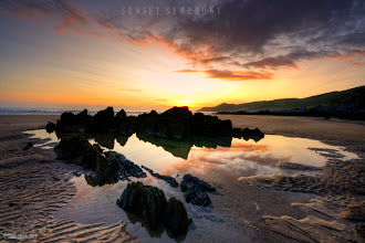 Photo: Combsegate Beach in North Devon UK, its a small cove nestled down a cliff, at sunset its even more beautiful.