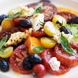 Heirloom Tomato Salad With Baked Ricotta And Olives.