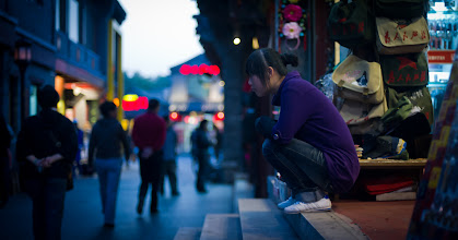Photo: Shopkeeper in Beijing on Steps  I was taking photos of the festive street at dusk, and I noticed this shopkeeper out taking a rest. I've always admired how people can rest in this position. I can only sit in that position for about 15 seconds before I scream in agony and my patellas pop off at a hyperspeed tangent.  from Trey Ratcliff at www.stuckincustoms.com