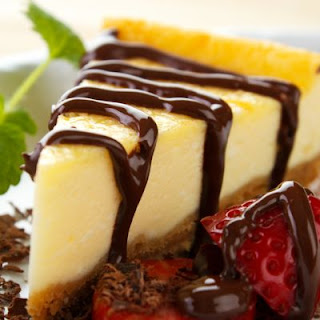Classic Cheesecake Drizzled In Chocolate