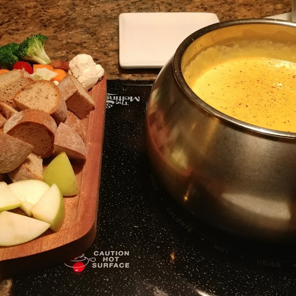 Wisconsin Cheddar cheese fondue with gluten free dipper plate. Fondue is gluten free with substitution of Red Bridge beer.