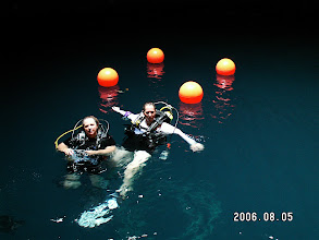 Photo: Divers inside a geothermal limestone dome, Utah.  They don't seem that happy to see me.