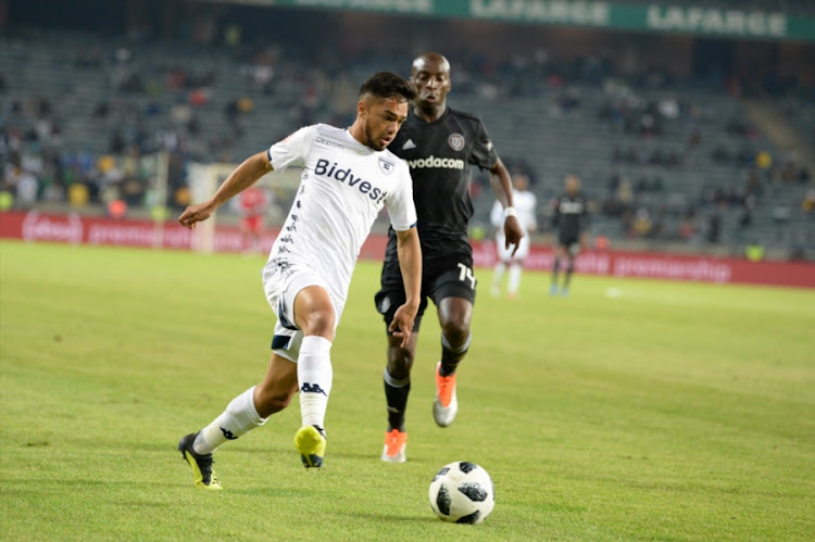 Haashim Domingo of Bidvest Wits pulls away from Musa Nyatama of Orlando Pirates during the Absa Premiership match at Orlando Stadium on August 15, 2018 in Johannesburg, South Africa.