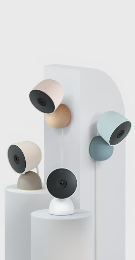 Nest Cams shown mounted on different pillars for scale and context.