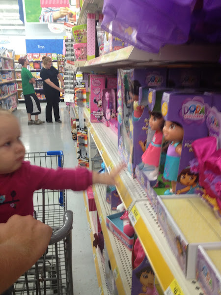 Photo: She wanted one of everything, but didn't cry and finally settled on a baby doll.