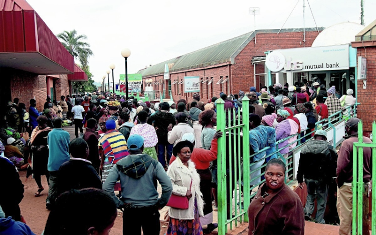 VBS Mutual Bank customers wait outside the bank in Thohoyandou, Limpopo to demand their money back in this October 17 2018 fie photo, Picture: SOWETAN/ANTONIO MUCHAVE