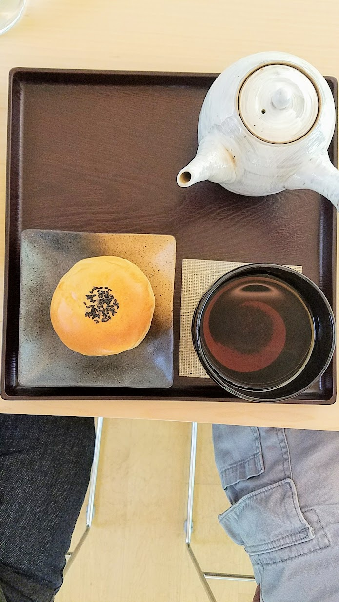 Visiting the Portland Japanese Garden Umami Cafe offering Japanese teas and snacks, Hojicha with Anpan set, a pastry with flavored red bean paste that highlights the aromatic sweetness of Hojicha tea, which is a roasted green tea