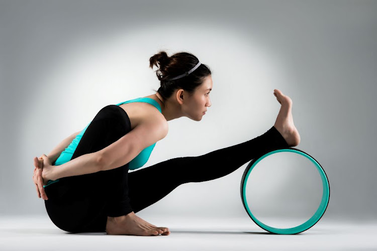 A yoga wheel can be used to help you stretch out.