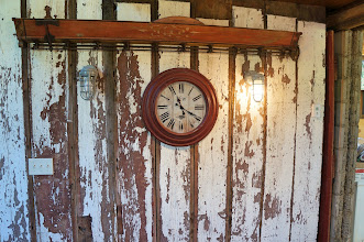 Photo: Weathered boards repurposed to make an interior wall in the converted barn.