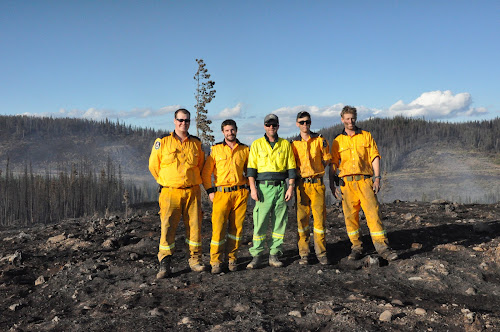 Narrabri firefighter Jock Smith at left with fellow crew members at the plateau fire in the Caribou region of British Columbia. With him are fellow Australians strike team leader Glyn Lloyd (Sydney), divisional commander Dash Burns (Victoria), Hayden Clark (Grafton) and Dane McAndrew (Southern Highlands).