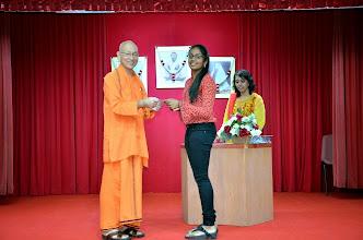 Photo: Varsha Ramkumar (PSLE) receiving the Award from Swamiji
