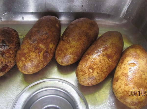 Wash the potatoes. Peel them then wash them again. Slice them into very thin...