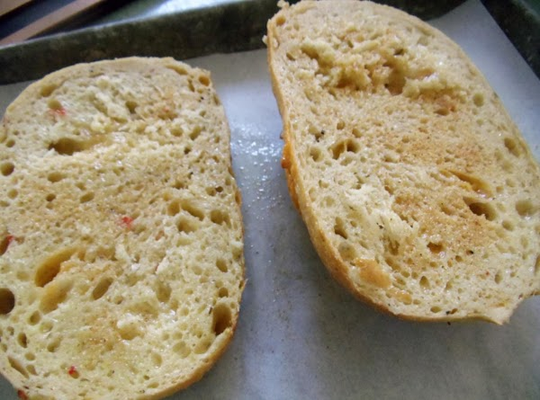 Once mixed, sprinkle garlic powder on the bread or rolls, spray with cooking spray...