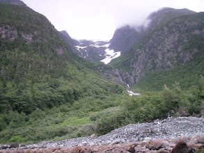 Photo: Snowfields and a waterfall in the Kakuhan Mountains.
