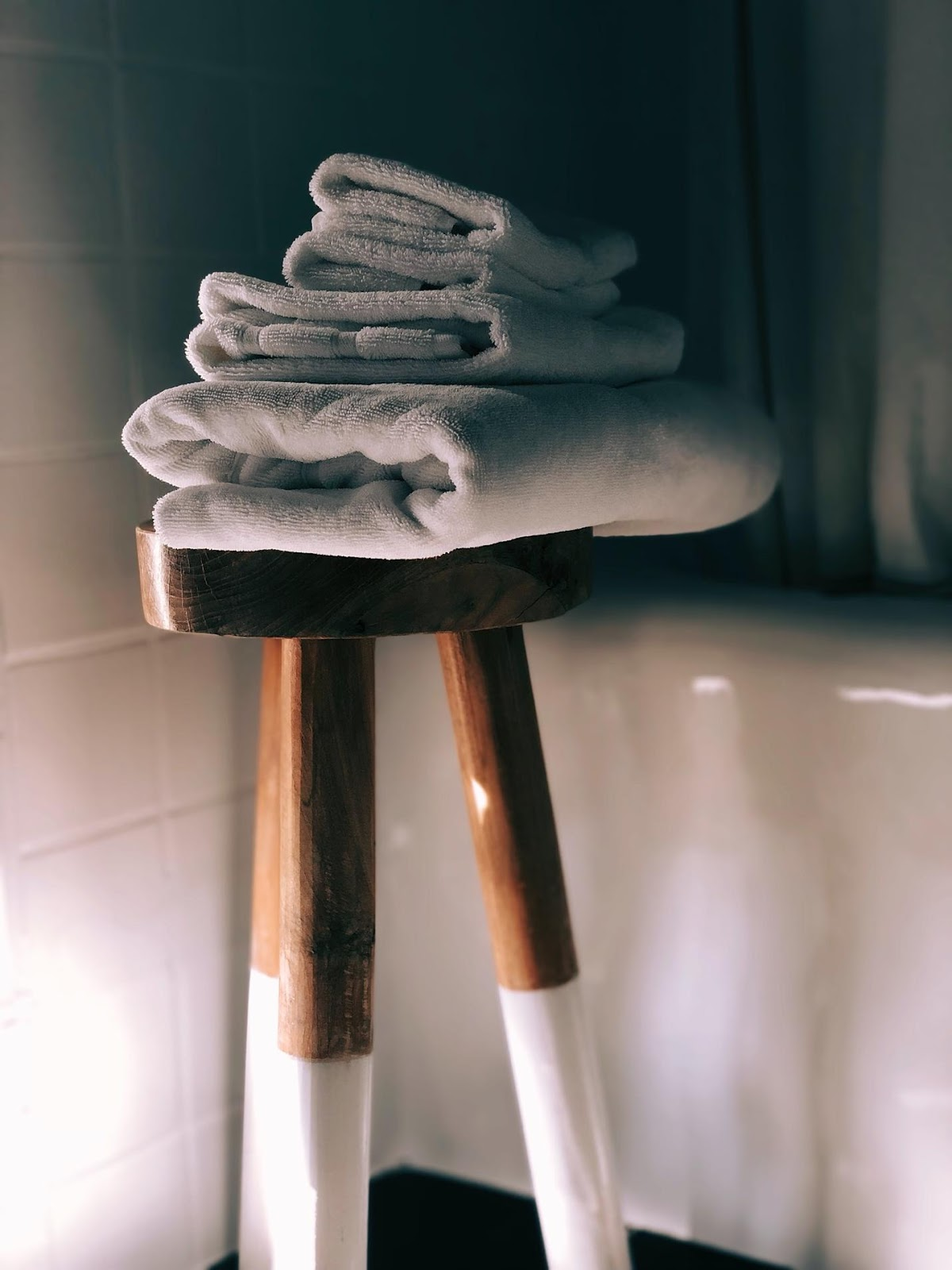 towels on a stool in the bathroom