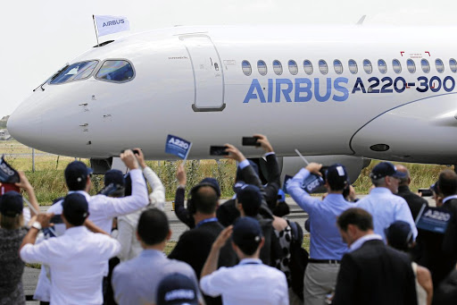 Airbus members celebrate the landing of an Airbus A220-300 aircraft during its presentation in Colomiers near Toulouse, France, July 10. REUTERS/Regis Duvignau