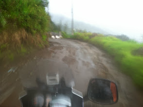 """Photo: um yeah, """"You'll experience Spring like weather in Ecuador"""" they say. Well it RAINS in Spring! Luckily Brian can ride and the """"wee-Strom"""" (a small 650cc Suzuki dual sport motorcycle) could handle pretty much anything we threw at it."""