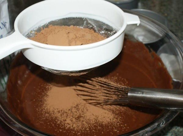 Sift cocoa into bowl and stir well blended. Pour batter into prepared pan.