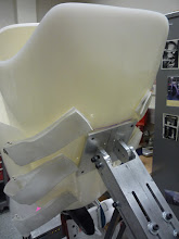 Photo: Attached the body cast to the support arm.