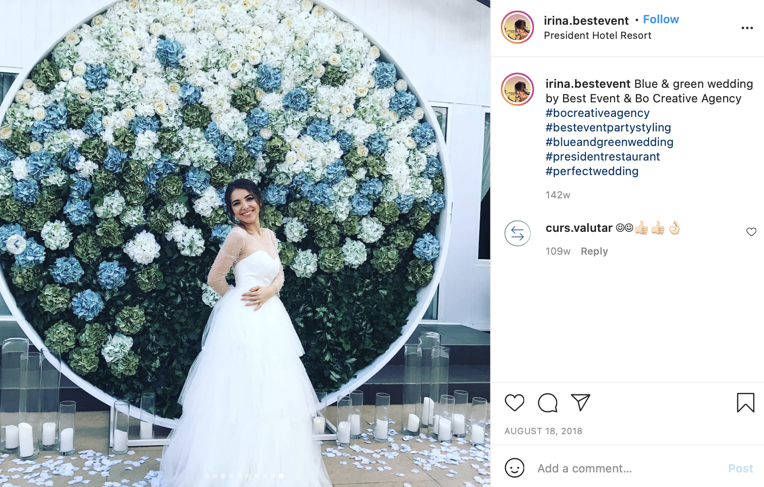 photo of bride behind dark green and pastel blue florals