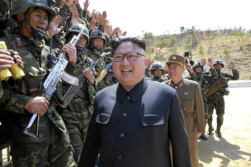 Confrontational: North Korean Leader Kim Jong-un is cheered by soldiers. Japan Prime Minister Shinzo Abe spoke with US President Donald Trump on Monday about growing threats after Pyongyang launched another intercontinental ballistic missile on Friday. Picture: REUTERS