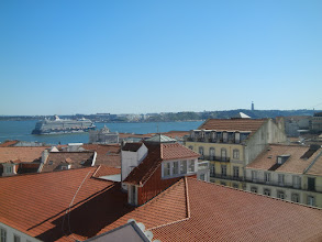 Photo: We stopped at a hotel with a big outdoor patio and a fabulous view to grab a cup of coffee. Lisbon rooftops with the Tagus River in the background.