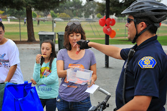 Photo: Officer Lopez helps draw out winners for the raffle.