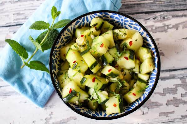 A Bowl Of Sweet & Spicy Cucumber Salad.