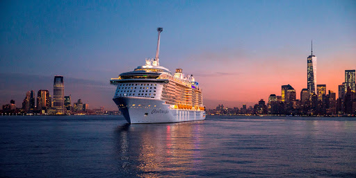 Quantum of the Seas in New York Harbor at twilight.