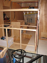 Photo: Bathroom to the right, and shelf over the kitchen going in.