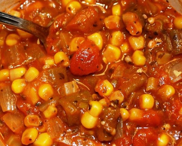 Add corn, and seasonings to taste. Simmer until okra is very tender and beginning...