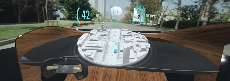 Extra-large head-up displays, like Nissan's I2V, will in future use the cloud to show what's behind a building or around the corner. Picture: SUPPLIED