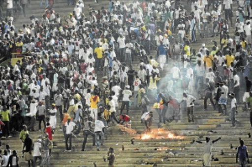 POOR LOSERS: Senegalese football fans light fires at Leopold Sedar Senghor stadium in Dakar on Saturday              . Senegal's African Nations Cup tie with Ivory Coast was abandoned on Saturday when riot police fired teargas inside the packed stadium              .            PHOTO: REUTERS
