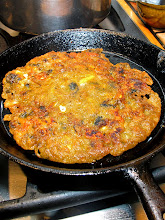 Photo: turning the mussel cake over when first side is browned and crispy