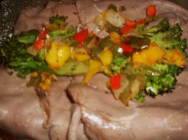 Heat oven to 400 degrees. Prep & slice broccoli, peppers and onions. Heat olive...