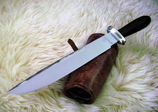 """Photo: Blade 9 1/2"""", overall length 14 1/4"""". Blade 440C stainless steel, Guard pieces and handle nut nickel silver. Handle Cocobolo Wood."""