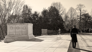 Photo: Guarding the Tomb of the Unknowns  The Tomb of the Unknowns has been patrolled continuously, 24/7, since 1930. I spent quite a bit of time at Arlington National Cemetery on my last trip. I took a few photos, but most of the time, I just observed. This shot was just before the changing of the guard. Very precise people, these guards. Twenty-one paces in each direction, twenty-one second pause before turning around, always keeping their rifle on the shoulder away from the Tomb itself.  When the Sergeant came out for the changing of the guard, it was interesting to note the precision of everyone's movements. They didn't talk. During their paces, one of them could not see the other behind him, yet everyone remained in perfect sync. Of course, they've practiced and drilled many times to achieve their precision. One web site said that each guard spends five hours each day preparing his uniform for the duty. It's a special duty and one that these guards don't take lightly. It's somewhat refreshing to observe that kind of dedication.  Please visit the blog at http://williambeem.com