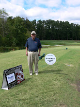 """Photo: Mike at the Dock Tripp May hole which was the """"Hole-In-One"""" for the Cadillac"""