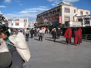 Photo: The pilgrims walk a kora, a clockwise circuit of a few blocks surrounding the Johkang Temple, through small winding streets.
