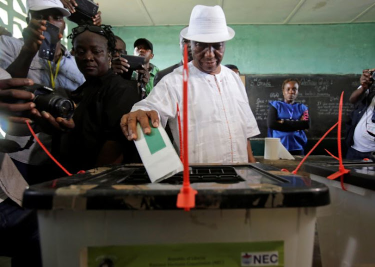 Joseph Nyuma Boakai, Liberia's vice president and presidential candidate of Unity Party (UP), votes at a polling station in Monrovia, Liberia, October 10, 2017.