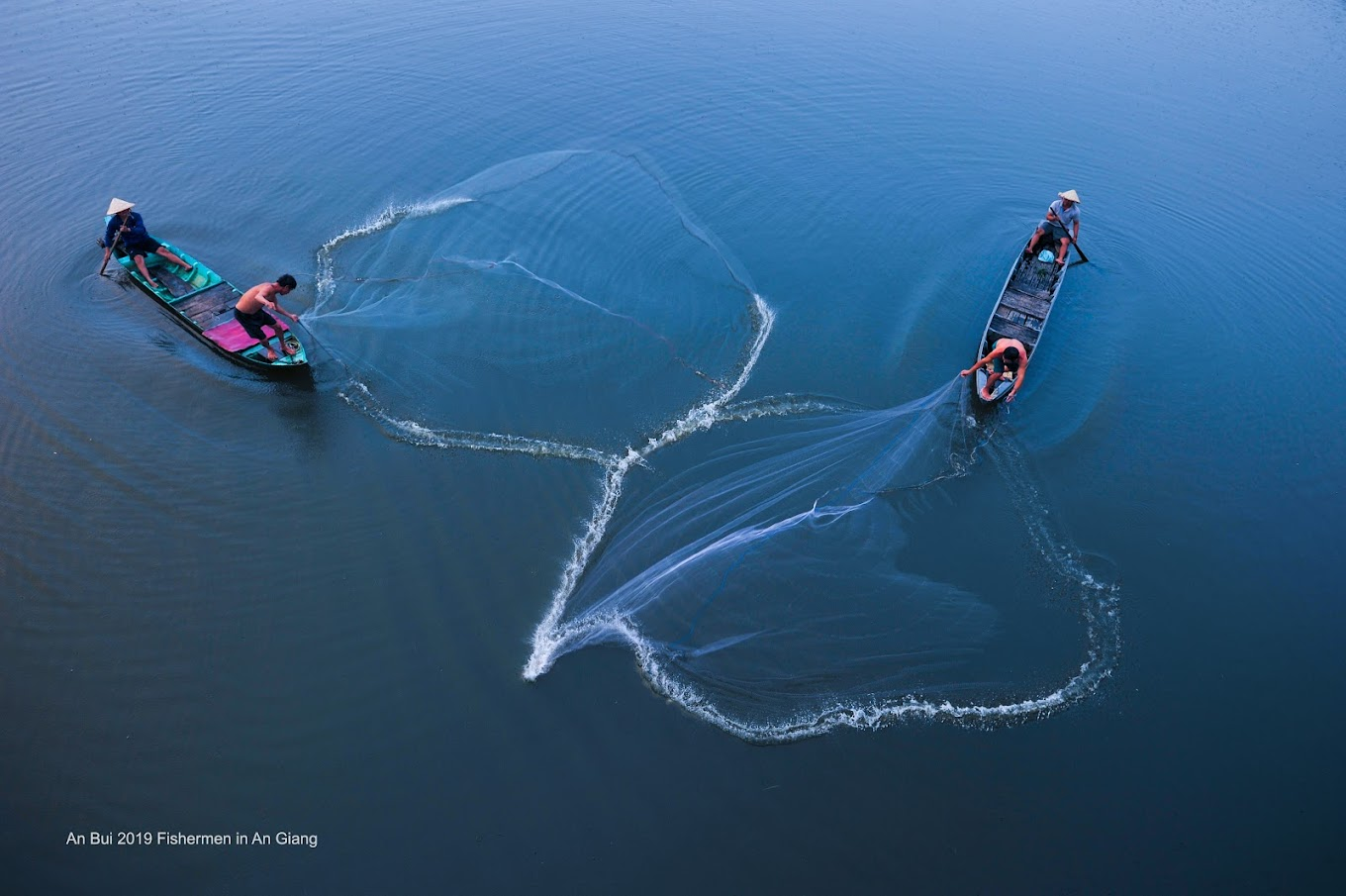 Fisherman throwing the fishing net in the river