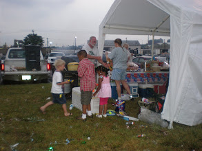 Photo: the kids around the bubble solution to make more bubbles