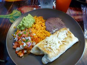 Photo: chimichanga, refried beans, Mexican rice, pico de gallo, and guac