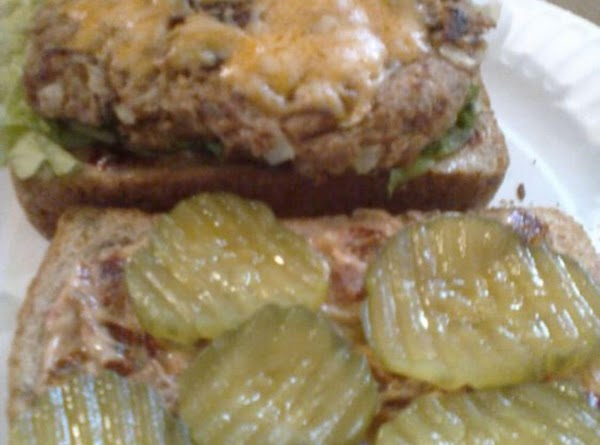 Arrange lettuce over dressing on two slices, add tuna patties, then top with pickle...