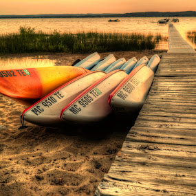 kayaks at sunset by Fraya Replinger - Transportation Boats ( michigan, kayaks, sunset, summer, pier, lake, beach, boat, kayak, dock,  )