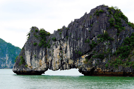 One of hundreds of granite rock formations and outcroppings in Ha Long Bay, Vietnam.