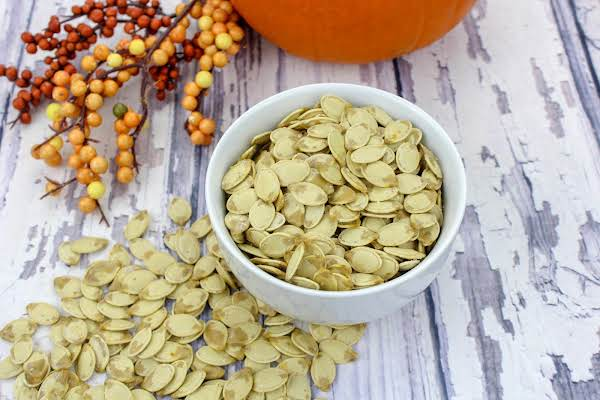 Lightly Salted Roasted Pumpkin Seeds In A Bowl.